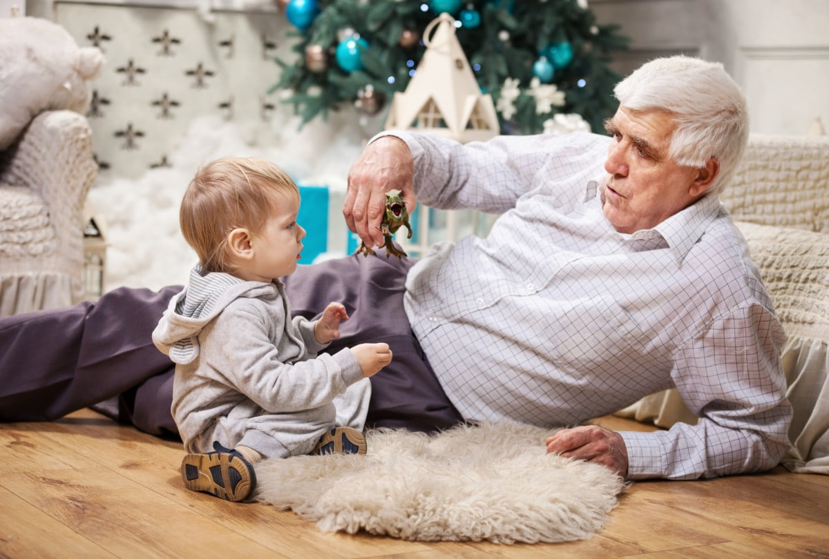 Grandpa and grandson with Christmas tree