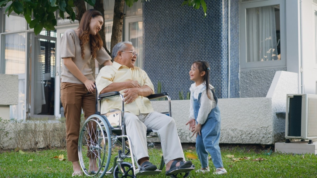 Grandpa in a wheelchair with family